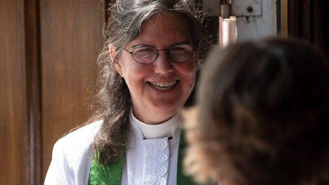 The Rev. Shay Craig, the new priest at St. Michael's Episcopal Church, welcomes a parishioner.