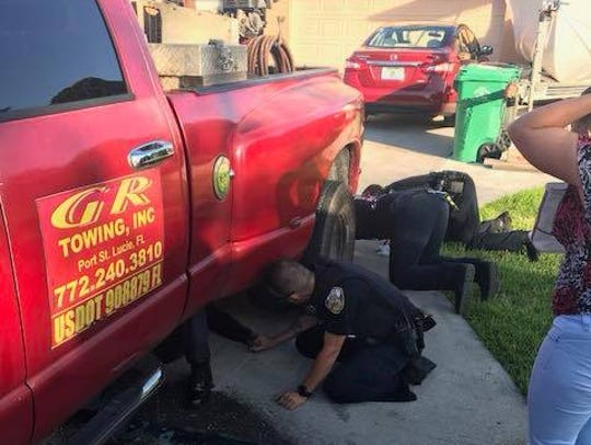 Port St. Lucie Police help man after truck lands on