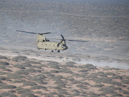 Task Force Desert Knights, led by Fort Bliss' 2-501st, practiced doing air assaults during the Army Warfighting Assessment. Here, a Chinook helicopter flies over the training area.