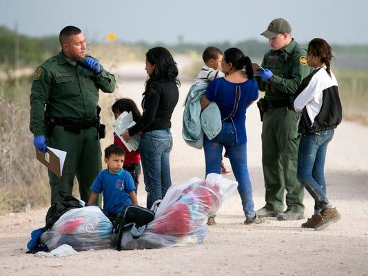 -NASBrd_07-20-2014_Tennessean_1_B002~~2014~07~19~IMG_Immigration_jump.jpg_1_.jpg