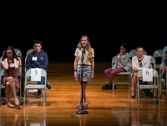 Savannah Anderson spells her word during the 40th Annual
