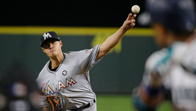 The Miami Marlins' Wei-Yin Chen pitches to the Mariners' Robinson Cano during the fourth inning Tuesday.