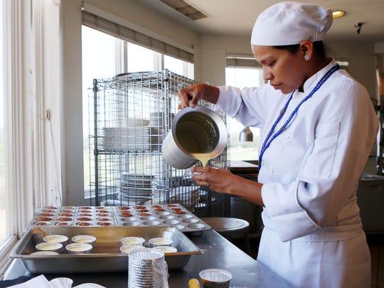 Antonia Brown prepares a batch of crème brûlée. Brown