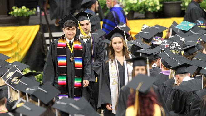 The newest graduates of the University of Iowa attend commencement ceremonies for the College of Liberal Arts and Sciences and University College on Saturday, May 13, 2017, at Carver-Hawkeye Arena.