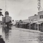 THEN: Flood waters fill the streets of downtown Phoenix on March 12, 1979. Heavy rains and snow melt from El Nino-related storms proved too much for existing infrastructure around Phoenix and Arizona in the 1970s.