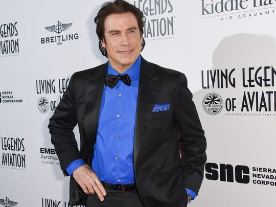 In this Jan. 16, 2015 file photo, John Travolta attends the 12th Annual Living Legends of Aviation Awards at The Beverly Hilton Hotel in Los Angeles.