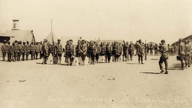 The funeral service held in Columbus for the eight 13th Cavalry soldiers killed in the Pancho Villa raid.  After the ceremony, the bodies of the soldiers were put on the train.