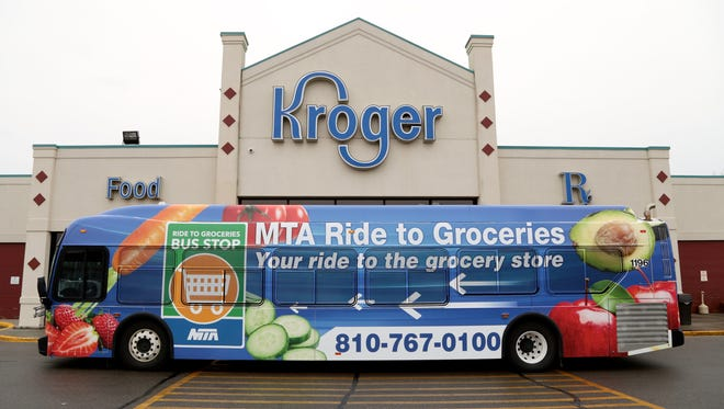 The new Ride to Groceries bus picks people from Kroger on Tuesday, February 2, 2016, in Flint, MI. The bus service takes residents to three grocery stores on the outskirts of city of Flint.