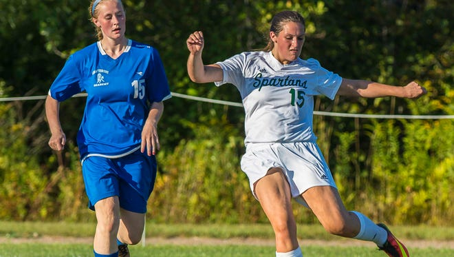 Winooski's Nicole Laplante, right, strikes the ball past Craftsbury's Mackenzie Blaney in Winooski  on Tuesday, September 6, 2016.