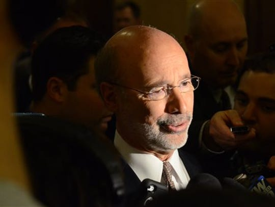 Gov. Tom Wolf responds to reporters' questions after
