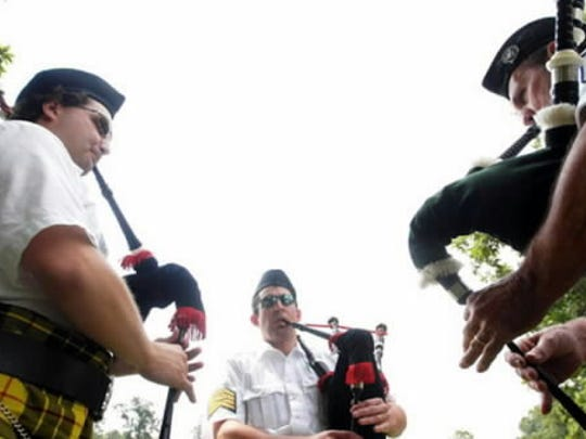 Members of the Lochiel Emerald Society practice the bagpipes prior to the opening ceremonies at the Adams County Irish Festival a few years ago.