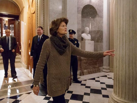 Sen. Lisa Murkowski, R-Alaska leaves the Senate chamber on Capitol Hill in Washington, Friday, Feb. 3, 2017, as lawmakers gathered for a predawn vote to advance the nomination of Education Secretary-designate Betsy DeVos. Murkowski and Sen. Susan Collins, R-Maine broke from the GOP and voted against DeVos. Despite vigorous opposition from Democrats, the Republican-led Senate voted 52-48 to cut off debate before dawn Friday morning, setting the stage for a final confirmation vote next week.