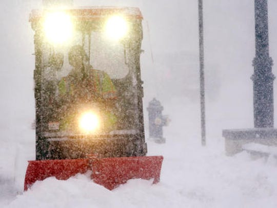 A sidewalk plow clears snow during a snowstorm, Thursday, Feb. 9, 2017, in Framingham, Mass.