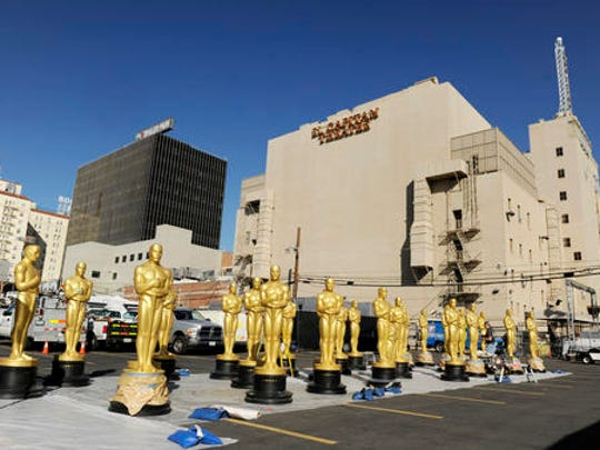 Oscar statues for Sunday's 89th Academy Awards red carpet stand in a parking lot near Hollywood Boulevard on Wednesday, Feb. 22, 2017, in Los Angeles.