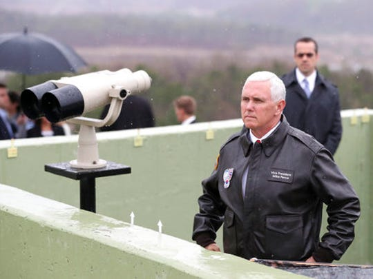 """U.S. Vice President Mike Pence looks at the North side from Observation Post Ouellette in the Demilitarized Zone (DMZ), near the border village of Panmunjom, which has separated the two Koreas since the Korean War, South Korea, Monday, April 17, 2017. Viewing his adversaries in the distance, Pence traveled to the tense zone dividing North and South Korea and warned Pyongyang that after years of testing the U.S. and South Korea with its nuclear ambitions, """"the era of strategic patience is over."""""""