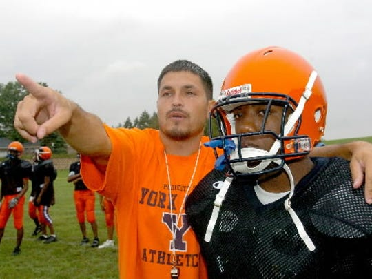 Matt Ortega directs a William Penn football player during a 2008 practice. Ortega, who coached at the school from 2004 to 2008, had a good track record of getting William Penn players to the college level. He's currently the head coach at Coatesville.