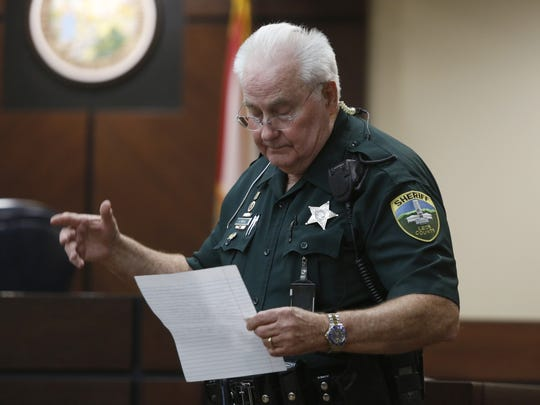 Leon County Sheriff's Bailiff Jimmy Beall reads a statement
