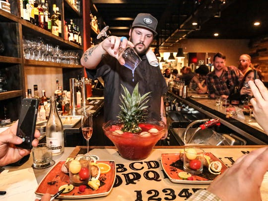 Bar tender Steve Simon mixes punch at the former Marrow, where he served as beverage director before the restaurant closed in 2017.