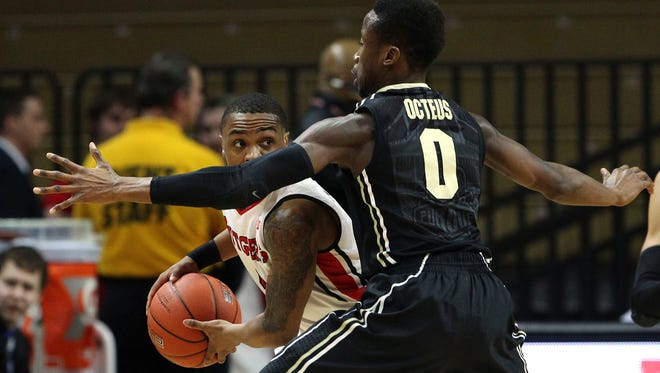 Feb 12, 2015; Piscataway, NJ, USA; Purdue Boilermakers guard Jon Octeus (0) defends against Rutgers Scarlet Knights guard Myles Mack (4) during the first half at Louis Brown Athletic Center. Mandatory Credit: Noah K. Murray-USA TODAY Sports