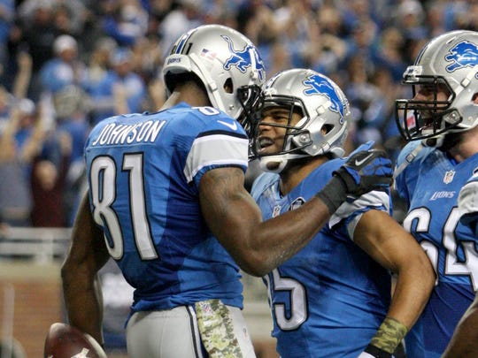 Detroit Lions wide receiver Calvin Johnson celebrates his touchdown with Golden Tate on Nov. 9, 2014.