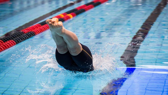 A swimmer competes in the 100 breaststroke during state finals in February at the Indiana University Natatorium. IU will host swimmers from six states, including six Woodson Y Northern Swimmers on Team Wisconsin, at the 14 & U Mid States All-Star Championships on Jan. 5-6.