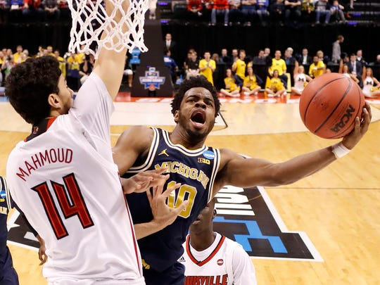 Michigan's Derrick Walton Jr. shoots against Louisville's Anas Mahmoud during the first half in the second round of the 2017 NCAA tournament at Bankers Life Fieldhouse.