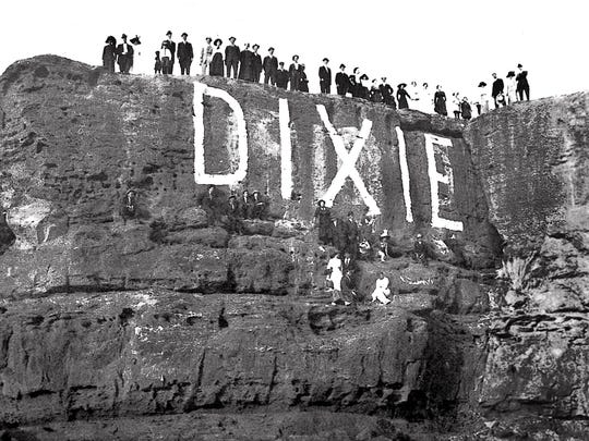 """To cease the conflict between classes, Dixie College began painting the word """"DIXIE"""" on the Sugarloaf in place of graduation years."""