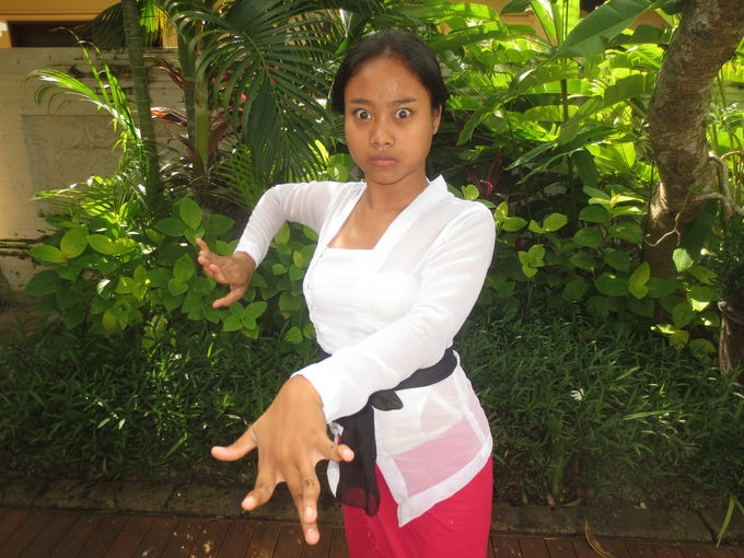 A Balinese teenager demonstrates the finger contortions