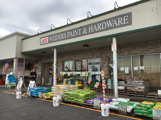 Phil Parcells, an employee in Weiders Hardware's service division, stands in front of the Honeoye Falls store.