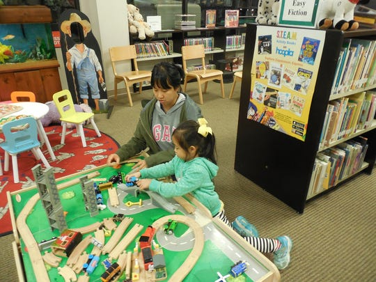 A mother and daughter enjoy the train table at Pike Road Branch Library. Representatives of College Counts 529 will be on hand at the popular Pike Road library at 3 p.m. on March 8 to help parents better understand higher education financing options available to them.