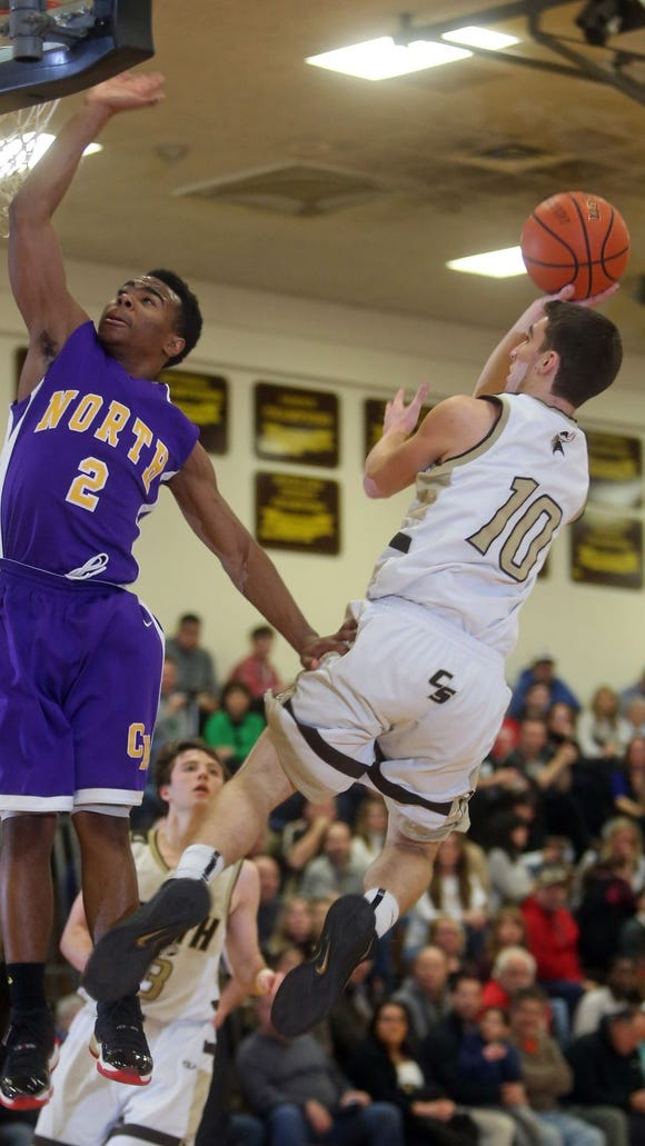Clarkstown South's Andrew Bunyan shoots over a defender on rival Clarsktown North. The Vikings visit New Rochelle on Tuesday, Dec. 15.