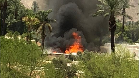 A house fire spread to another building and injured a firefighter Tuesday in Rancho Mirage.