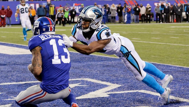 Carolina Panthers' Josh Norman (24) tackles New York Giants' Odell Beckham (13) in the end zone as Beckham scores a touchdown during the second half of an NFL football game Sunday, Dec. 20, 2015, in East Rutherford, N.J. (AP Photo/Julie Jacobson)