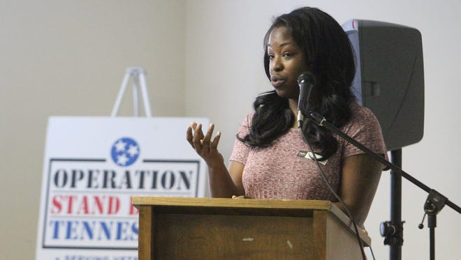 Shontel Foster, an Army veteran, tells her story Wednesday at Operation Stand Down's inaugural Heroes Breakfast in Clarksville.