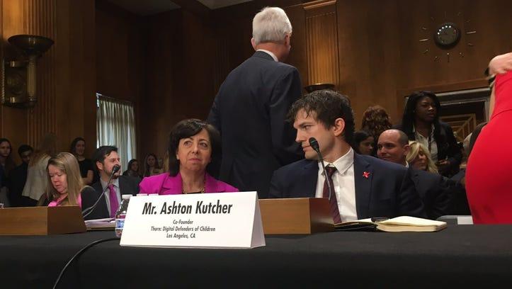 Ashton Kutcher prepares to speak to the Senate Committee on Foreign Relations Wednesday, Feb. 15, 2017, in Washington, D.C.