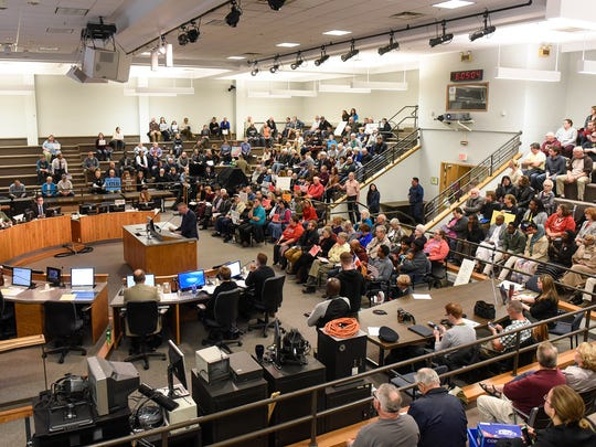 People wait for discussion to turn to a proposed moratorium on refugees during the Monday, Oct. 23, St. Cloud City council meeting.