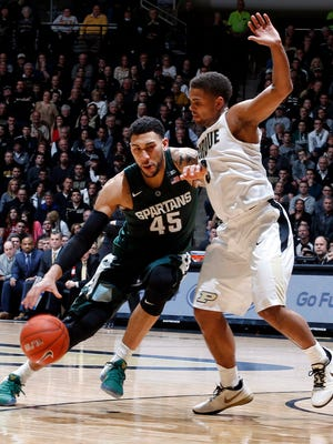 Feb 9, 2016; West Lafayette, IN, USA; Michigan State Spartans guard Denzel Valentine (45) drives to the basket against Purdue Boilermakers guard P.J. Thompson (3) at Mackey Arena. Purdue defeats Michigan State 82-81 in overtime. Mandatory Credit: Brian Spurlock-USA TODAY Sports