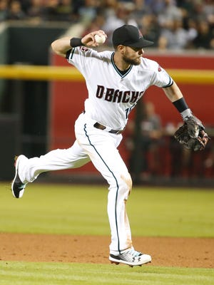 Arizona Diamondbacks second baseman Chris Owings (16) fields a ball during the sixth inning of a  MLB against the Houston Astros game at Chase Field in Phoenix, Az., on May 4, 2018.