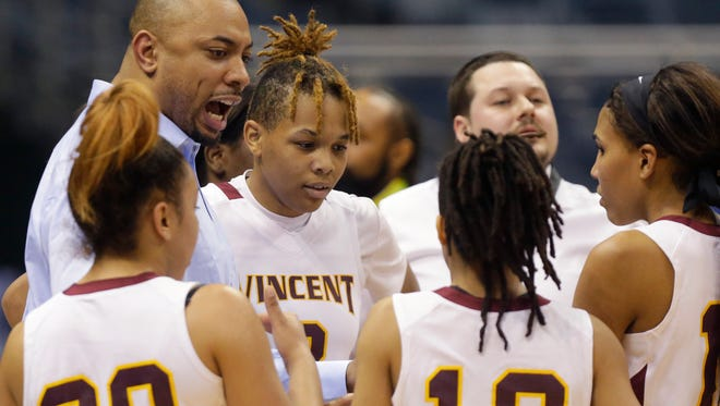 Milwaukee Vincent  coach James Wright addresses the team, including (from left) Faith Finch, Savanna Guthrie and Nelida Colon-Rodriguez.