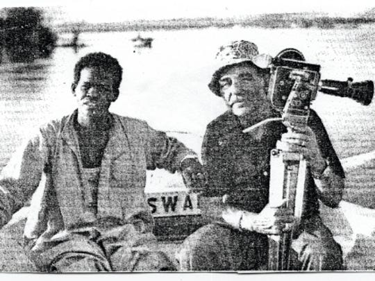 Al Bell at work with a tour guide on the Nile River.