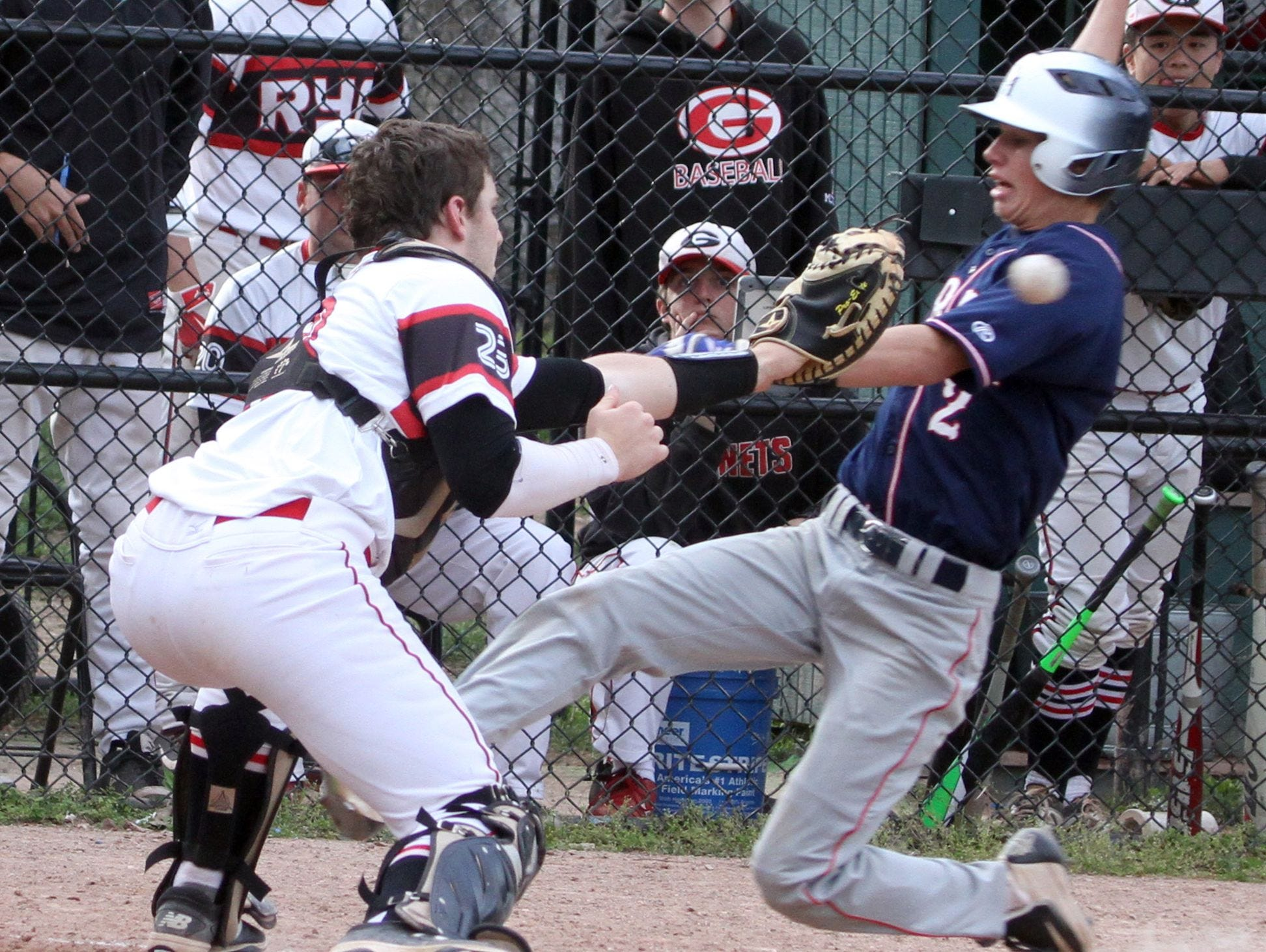 Nick Schaefer of Bryam Hills is tagged out by Rye catcher Chase Pratt during a varsity baseball game at Disbrow Park in Rye May 10, 2016. Byram Hills defeated Rye 4-0.