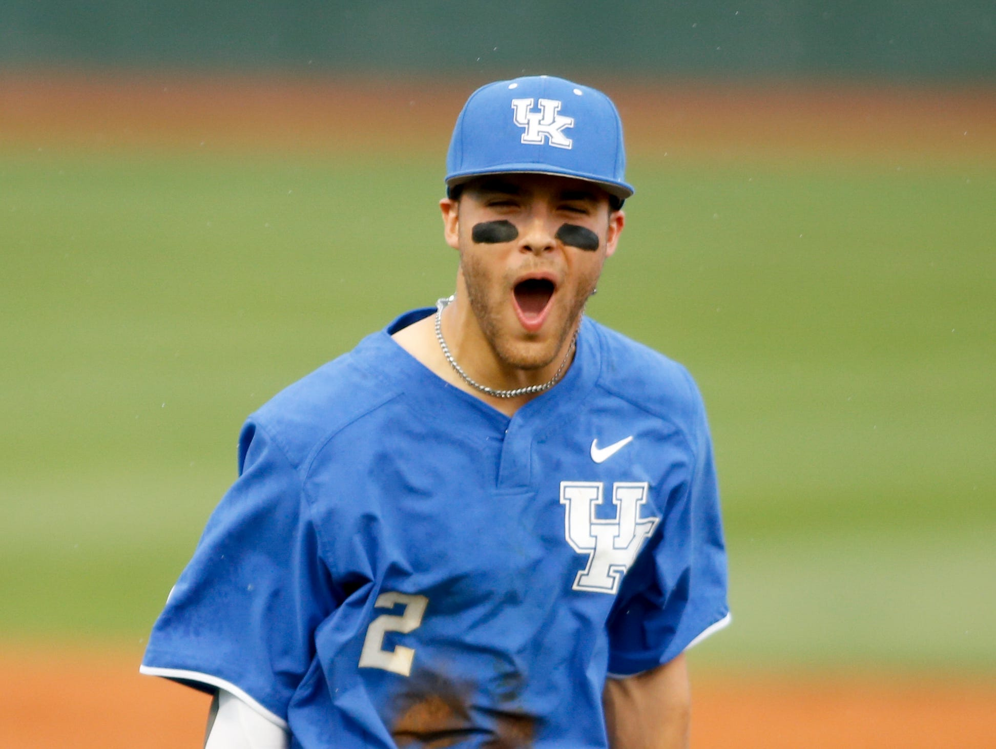 Kentucky Wildcats second basemen Riley Mahan celebrates after they turned a triple play in the second inning during the game against the Louisville Cardinals at Cliff Hagan Stadium in Lexington, Kentucky on Tuesday, April 18, 2017. Michael Reaves/Special to The Courier Journal