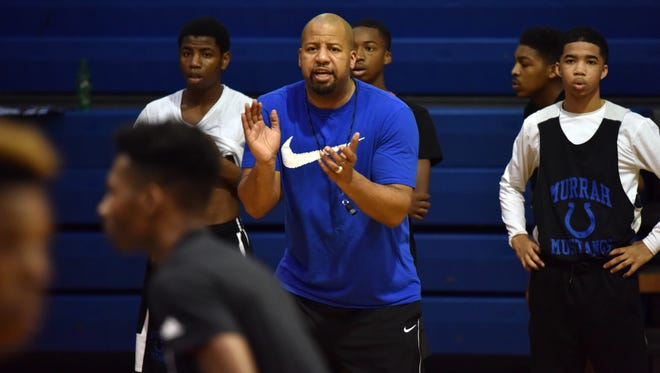 Murrah High School Basketball coach Perry Fletcher coaches his team during practice Monday at Murrah High School. Fletcher, also a minister at a local church, works to prepare his team for the 6A quarterfinals.