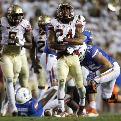 FSU's Terrance Smith screams out after sacking Florida
