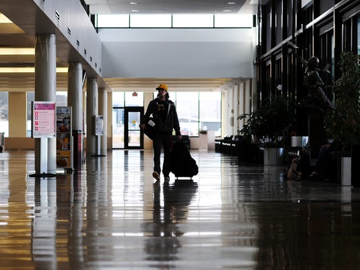 Colin Karst walks to the ticket counter on Thursday, April 17, 2014, at the Sioux Falls Regional Airport in Sioux Falls. (Joe Ahlquist / Argus Leader)
