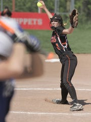 Lucas' Erica Westfield pitches during a district final game against Crestline at Shelby High School on Tuesday.