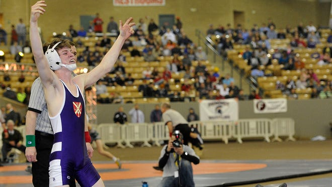 Father Ryan's Christian Simpson celebrates his Division II 106-pound state title win over MBA's Thomas Bellet.