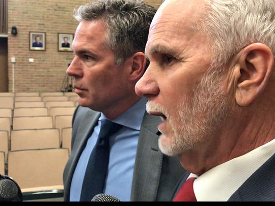 Tom McGraw, left, a labor attorney representing the City of Troy, said city officials could not comment in detail about the alleged assault because they had not yet seen the police report. Mayor Dane Slater is at right.