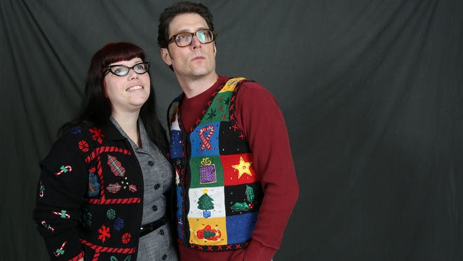 Statesman Journal reporters Carlee Wright and Tom Mayhall Rastrelli sport their ugly Christmas sweaters last December. Can you top them? What are your weirdest holiday traditions?