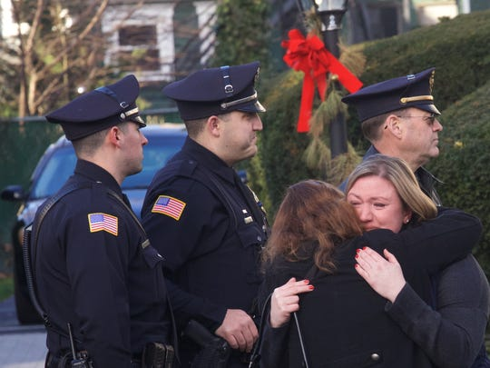 Some wept, some embraced, all were somber at the wake for Deal Police Captain Earl Alexander